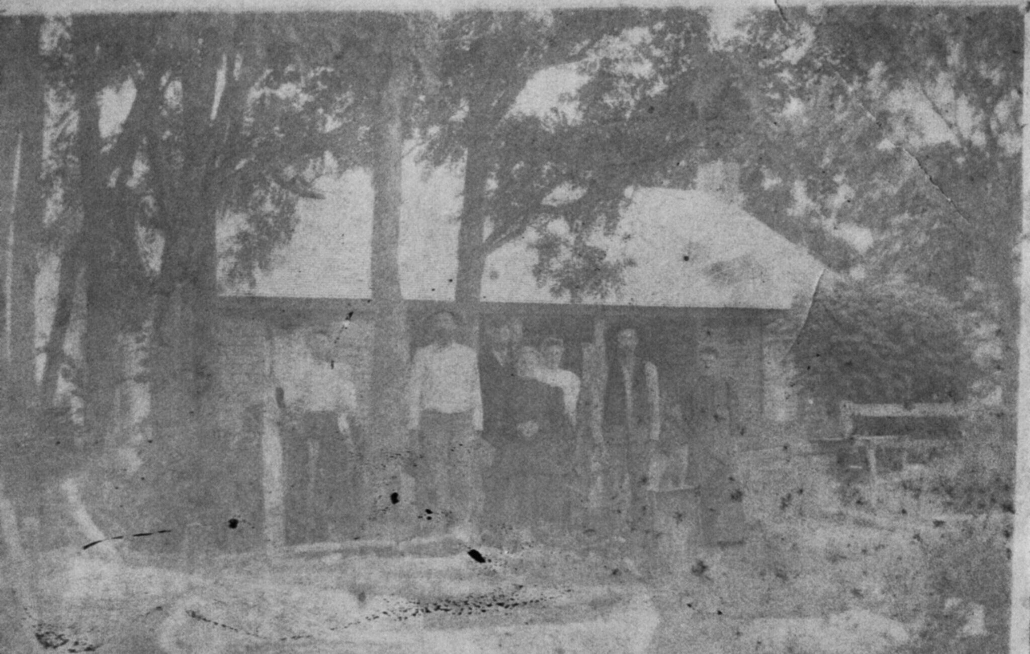 photo of wood house with family